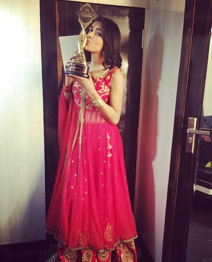 Eisha Singh with her awards